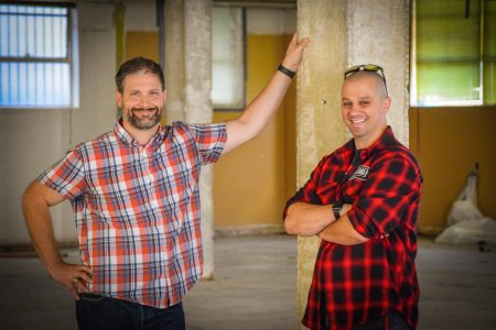 Ficklewood Cider owners Joe Farrier (left) and Stefan Enjem (right) stand in the future space of their cidery. Photo by Brian Addison.