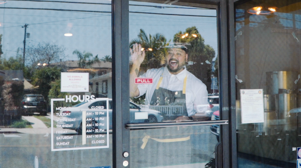 Chef AC Boral in the window of what will become his first brick and mortar restaurant. Photo courtesy AC Boral.