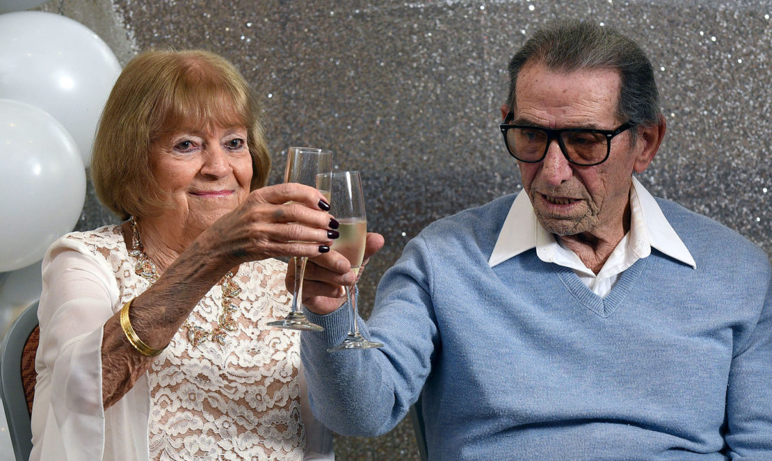Dee and Tuff Mancini raise a toast after they renewed their vows. Photo by Bill Alkofer.