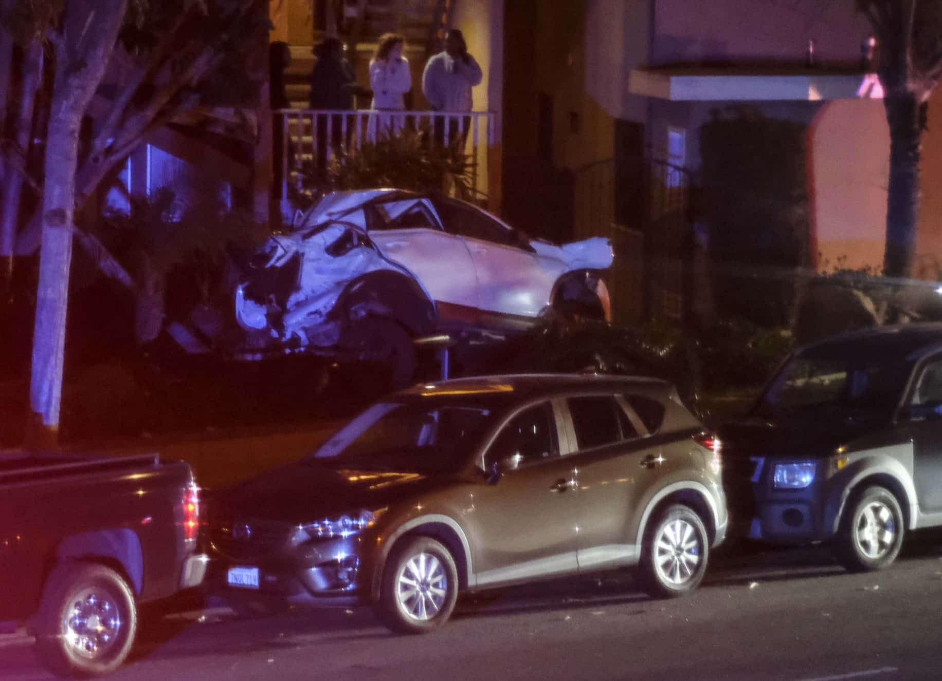 Driver found unconscious after high-speed crash into parked