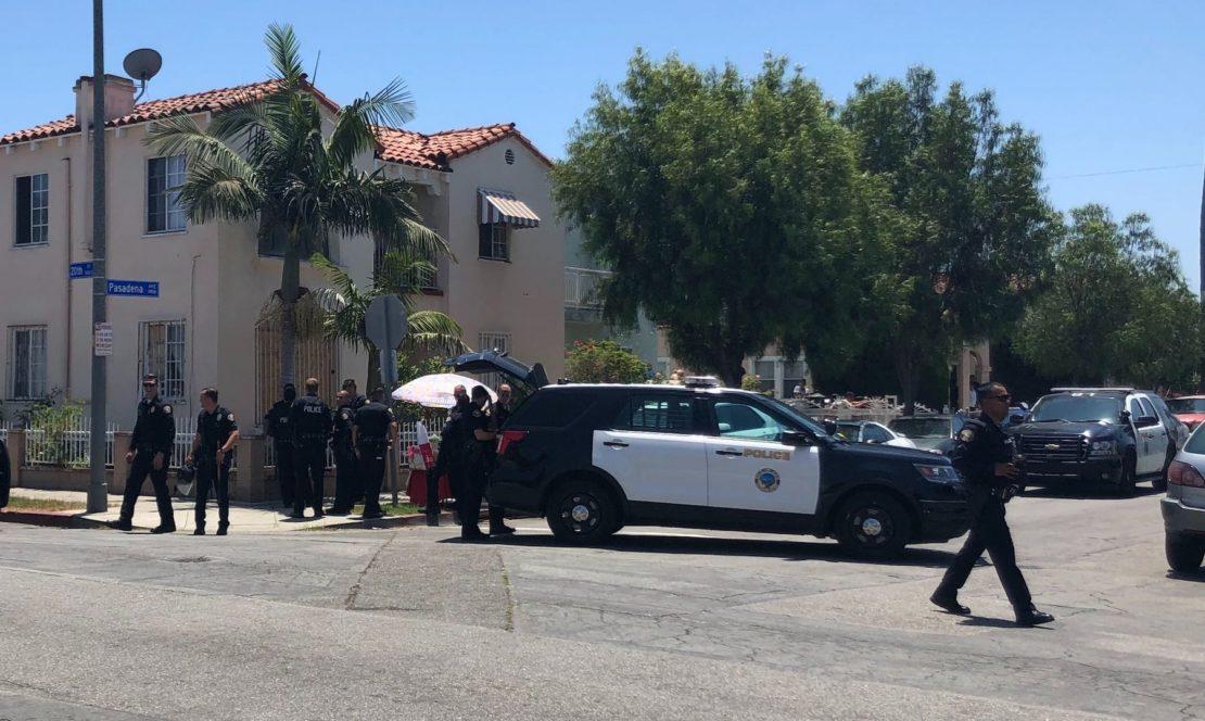 Police outside Holy Innocents Church. Photo by Stephanie Rivera.