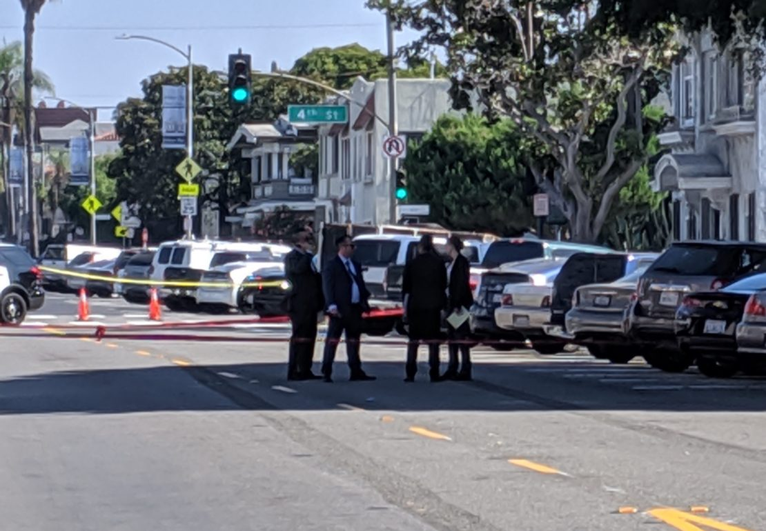 Detectives at the scene of a homicide on Magnolia Avenue Thursday morning. Photo by Valerie Osier.