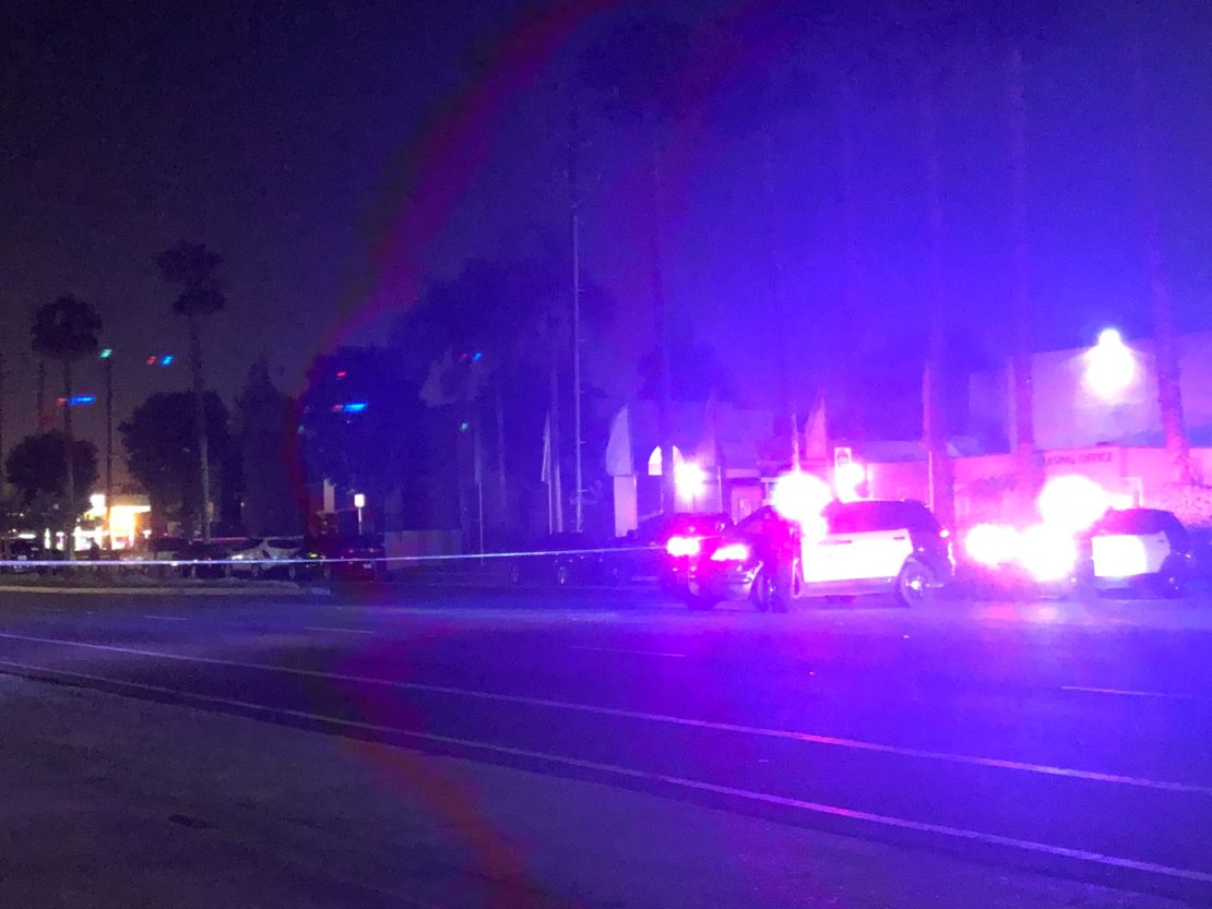 Police on Paramount Boulevard after two people were stabbed in a large fight. Photo by Stephanie Rivera.