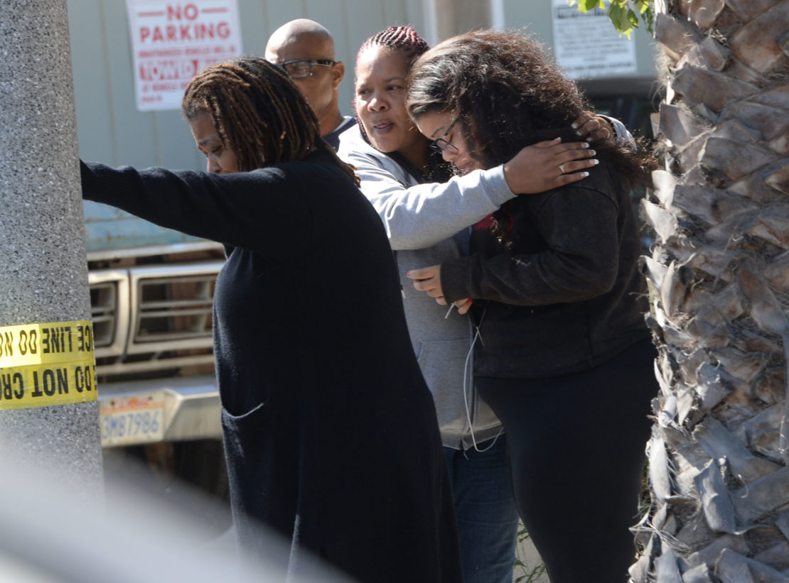 Family members after the Los angles Coroners office talks with family members of victims, at the scene of a Halloween party shooting, where three people were killed and nine injured tuesday night, at an apartment complex behind a nail salon on 7th Street near Temple Avenue. Long Beach California, Wednesday, October 30, 2019. Photo by Stephen Carr