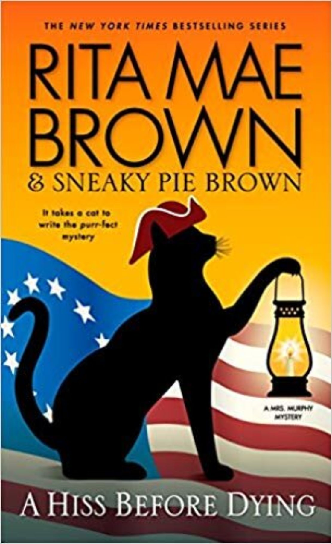 Book cover of A Hiss Before Dying by Rita Mae Brown and Sneaky Pie Brown. Black cat silhouette with red Paul Revere hat and holding a lantern backed by a U.S. flag with 13 stars.