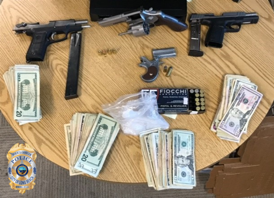 Gun and money seized during an illegal gambling raid on Wednesday Oct. 16, 2019. Photo courtesy Long Beach police.