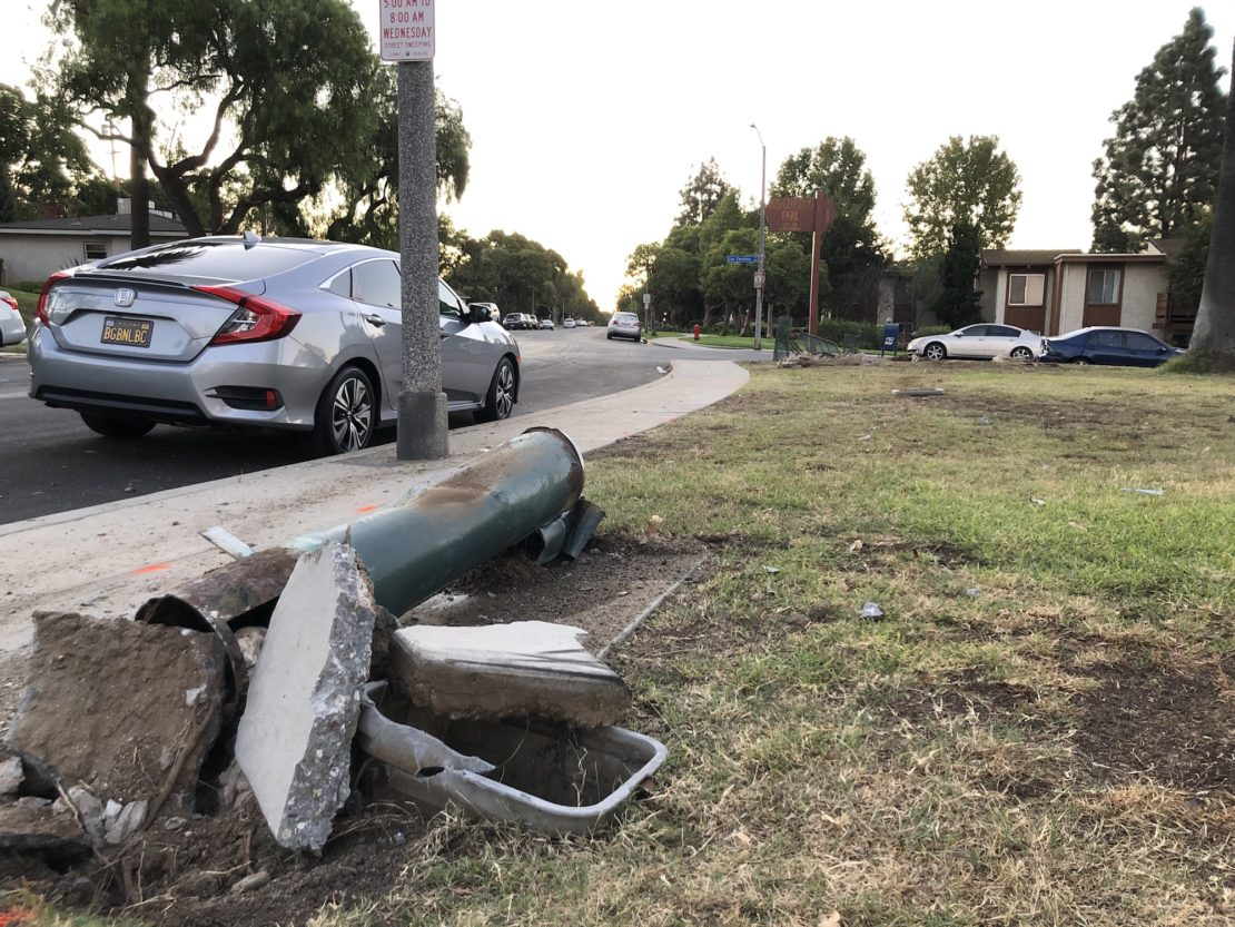 The wreckage after an SUV jumped a curb and hit two adults and a child walking along Los Cerritos Park. Photo by Jeremiah Dobruck.