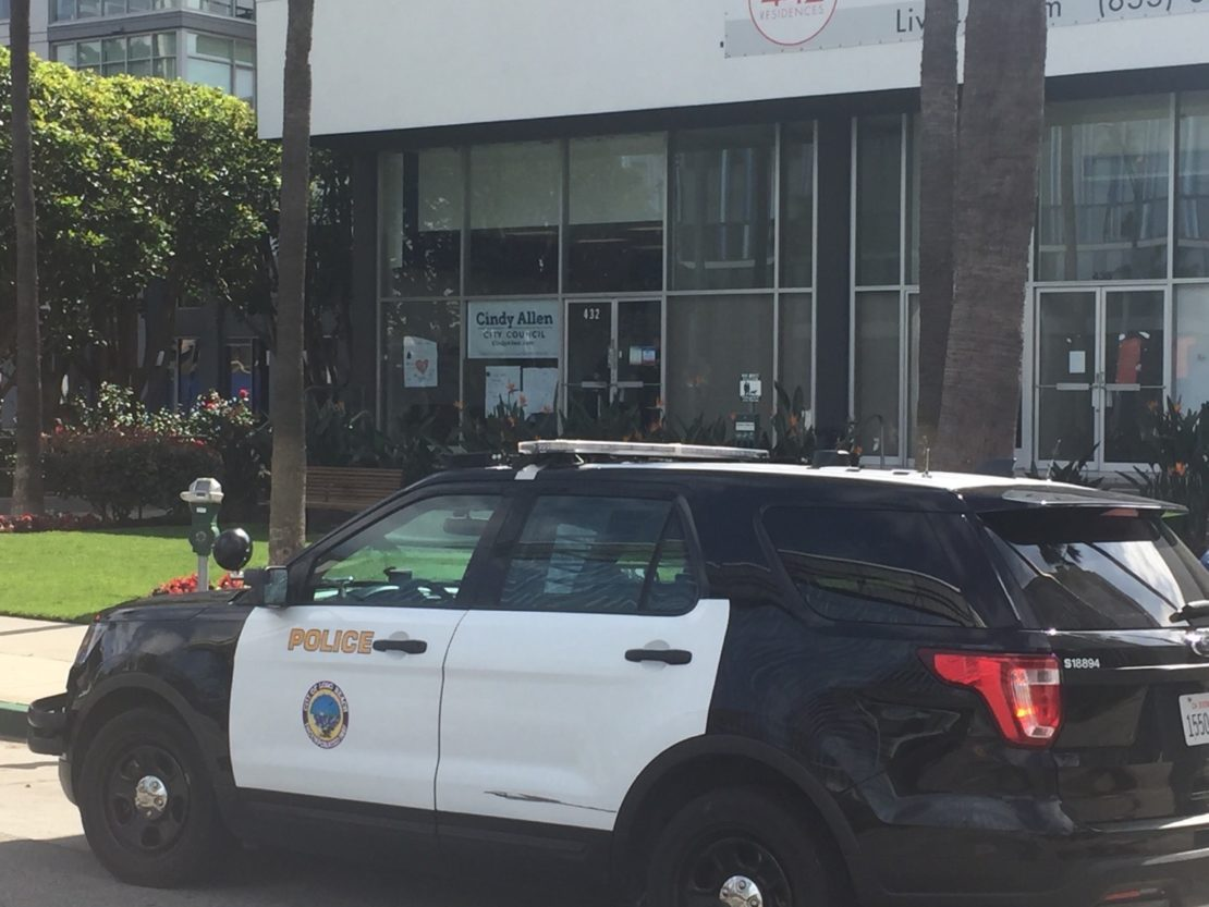 A Long Beach Police Department vehicle is parked in front of the campaign office of 2nd District council candidate Cindy Allen after anti-police protestors demonstrated in front of the building on the morning of Sunday, Feb. 23, 2020. Allen said protestors vandalized her office and violently attempted to open the office door. Photo by Curtis Herod.