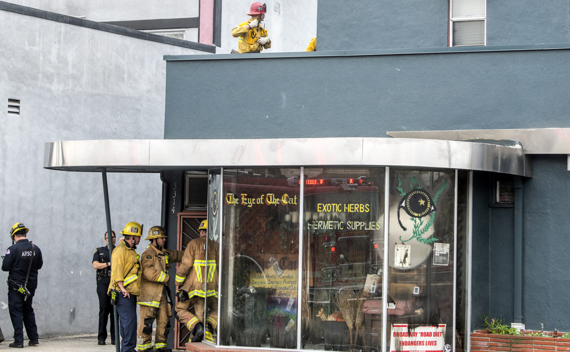 Long Beach firefighters mopping up after a blaze charred the inside of Eye of the Cat on Monday, March 9, 2020. Photo by Thomas R. Cordova.