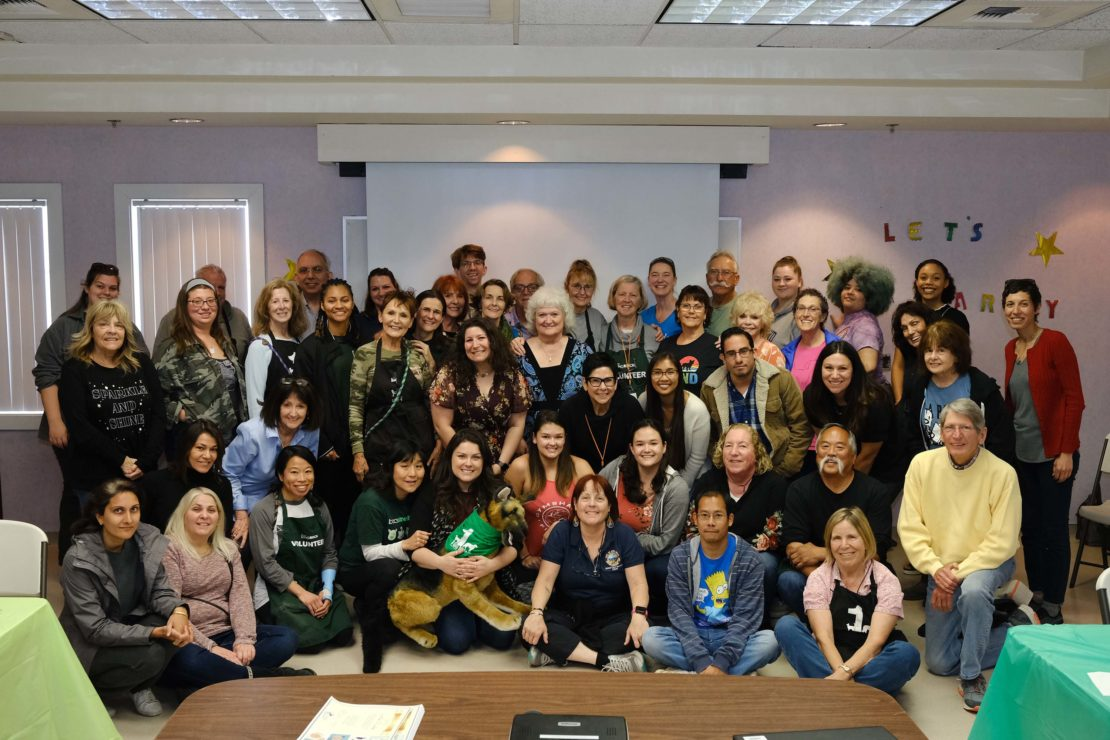 Large group of people posing for photo at Long Beach Animal Care Services