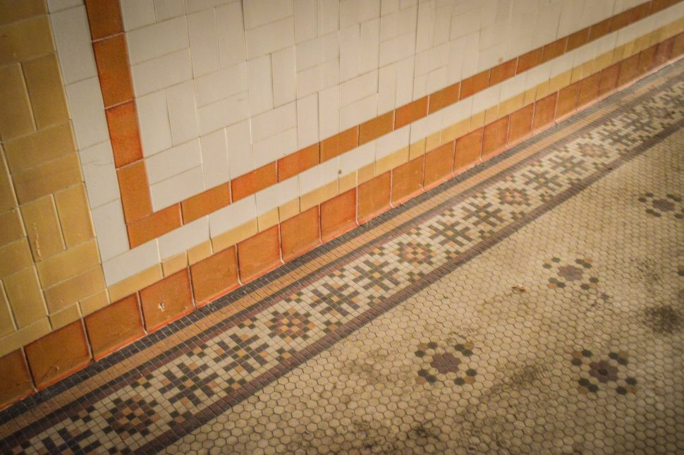 Tile details line the floors and walls of the Jergins Tunnel. Photo by Brian Addison.