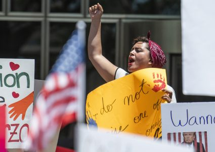 Paula Patino, of Long Beach, joins thousands in protest of Trumps zero tolerance policy in front of the Glenn Anderson Federal Building in Long Beach June 30, 2018. Photo by Thomas R Cordova