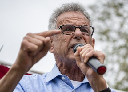 Congressmen Alan Lowenthal speaks at a rally where thousands show up in protest of Trumps zero tolerance policy as they marched from Cesar E. Chavez Park to Glenn Anderson Federal Building in Long Beach June 30, 2018. Photo by Thomas R Cordova