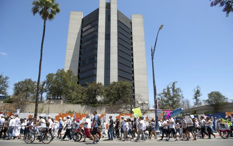Thousands protest of Trumps zero tolerance policy as they march in front of the city hall as they protested from Cesar E. Chavez Park to Glenn Anderson Federal Building in Long Beach June 30, 2018. Photo by Thomas R Cordova