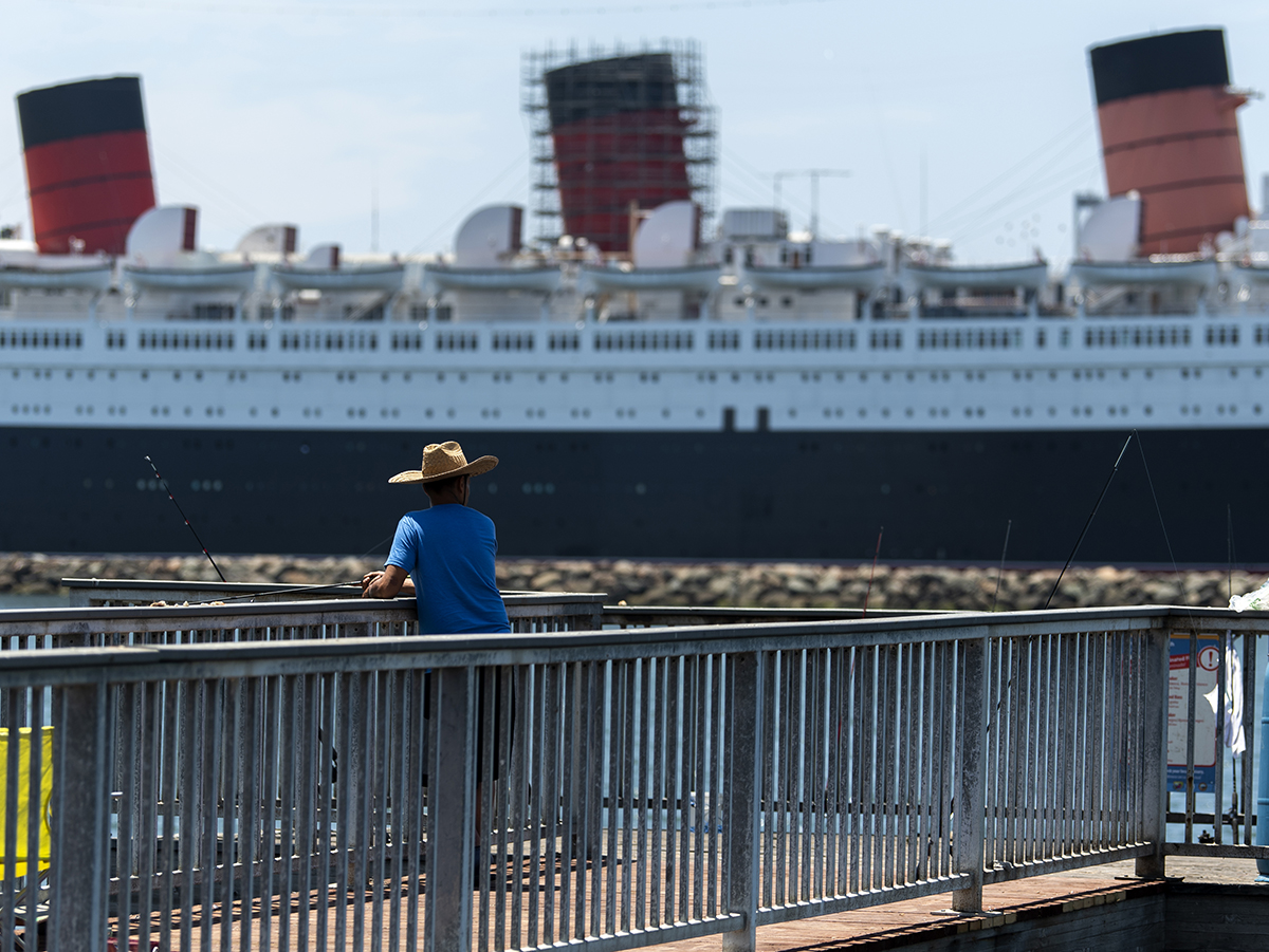 A Fisherman Casts His Fishing Rod Of Pier Across From The Queen Mary In Long Beach July 19 2018 Photo By Thomas R Cordova