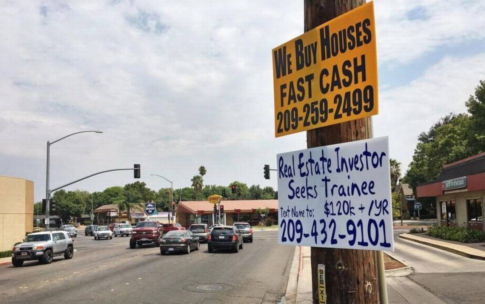 """""""We Buy Houses in Cash"""" signs are proliferating across California, drawing in quick sellers with quick buyers. Photo courtesy of Tim Ragsdale/Modesto Bee."""