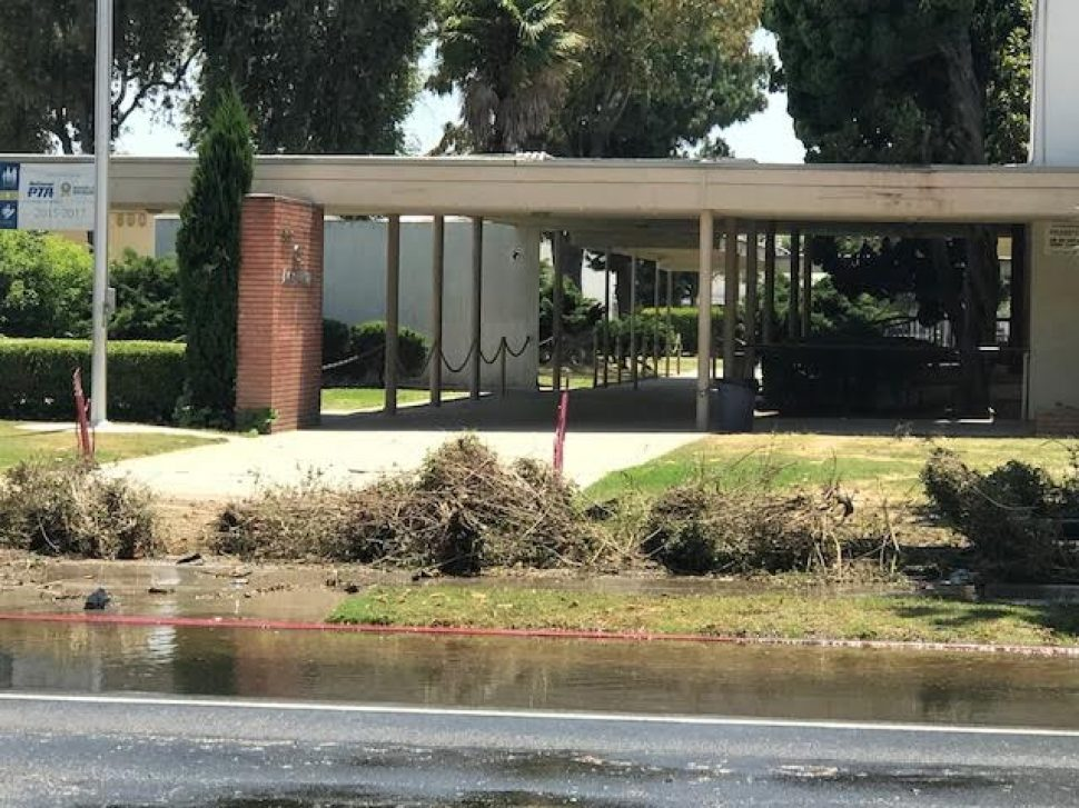 Nearly 50 yards of debris is left behind after a vehicle struck a fire hydrant and rolled over. Photo by Tim Grobaty.