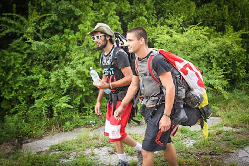 "Tyler ""Biddy"" Bidwell (left) and Pete Miljevic (right) hike along Hwy. 70 in Tennessee. Courtesy photo."