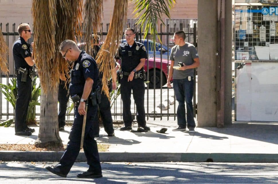 Long Beach police investigate a shooting on Pacific Avenue near Ninth Street on the afternoon of Wednesday, Aug. 29, 2018. Photo by Thomas R. Cordova.