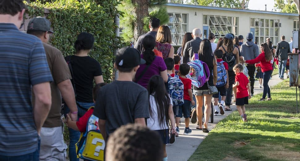 School kids and their parents make there the way to Gant Elementary School on the first day of school in Long Beach August 29, 2018. Photo by Thomas R Cordova/Safe Streets