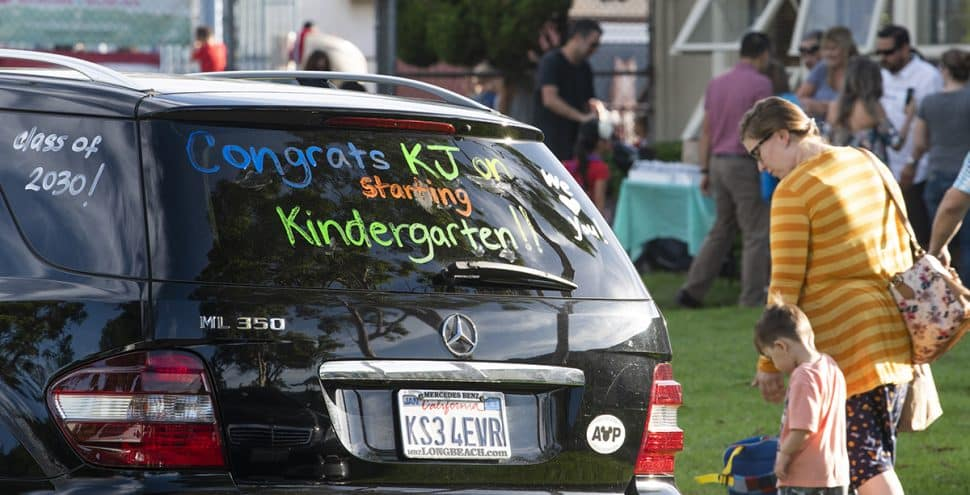 A proud parent vehicle celebrates the first day of school at Gant Elementary Schools as kids and their parents make there the way to class in Long Beach August 29, 2018. Photo by Thomas R Cordova/Safe Streets