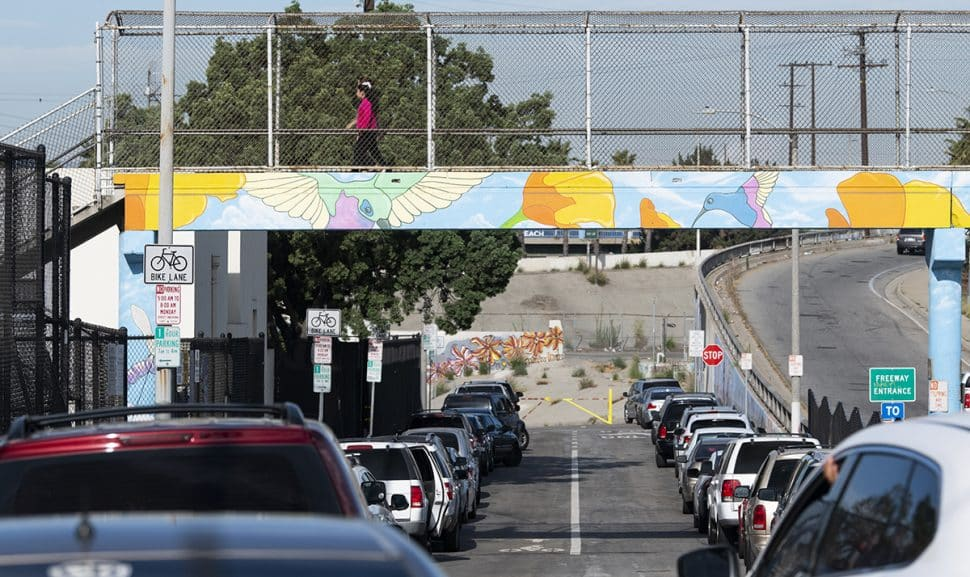 A girl crosses a pedestrian bridge over 7th Street to Edison Elementary School on the first day of school in Long Beach August 29, 2018. Photo by Thomas R Cordova/Safe Streets