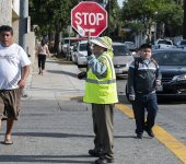 Lorena Gomez crosses parents and school kids safely at Daisy Avenue at 7th Street at Edison Elementary School in Long Beach August 29, 2018. Photo by Thomas R Cordova/Safe Streets