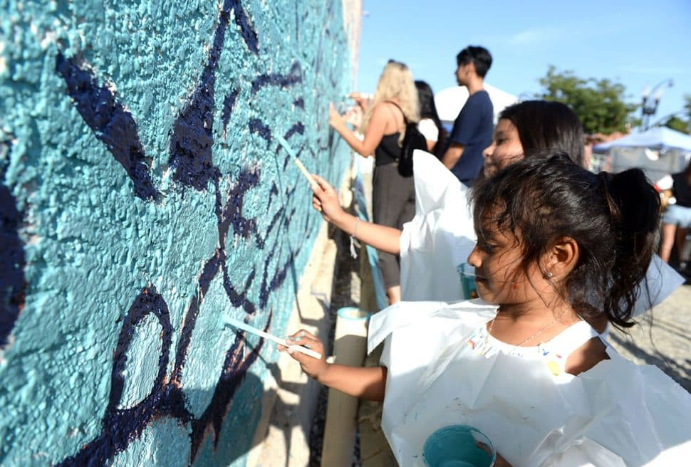 """Vicktoria Recendez,4, paints a mural called """" Celstia Butterfly """" during Summer LuvinÕ Fest, at 5301 Long Beach Boulevard in North Long Beach Saturday. The free family friendly event featured multiple bands, as well as vendors, artists and the Long Beach local El Exclusivo food truck on site in Long Beach Saturday, September 1, 2018.<br /> Photo by Stephen Carr / For The Long Beach Post"""