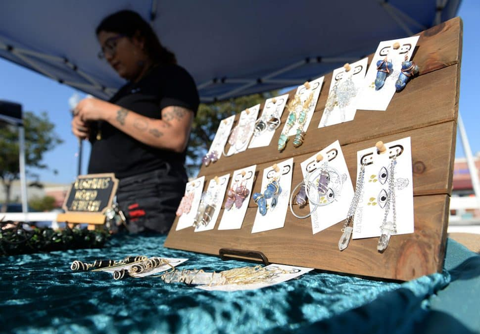 Katrina Garcia, owner of LaGrimas De Oro Jewelry makes jewelry at her booth during Summer LuvinÕ Fest, at 5301 Long Beach Boulevard in North Long Beach Saturday. The free family friendly event featured multiple bands, as well as vendors, artists and the Long Beach local El Exclusivo food truck on site in Long Beach Saturday, September 1, 2018.<br /> Photo by Stephen Carr / For The Long Beach Post