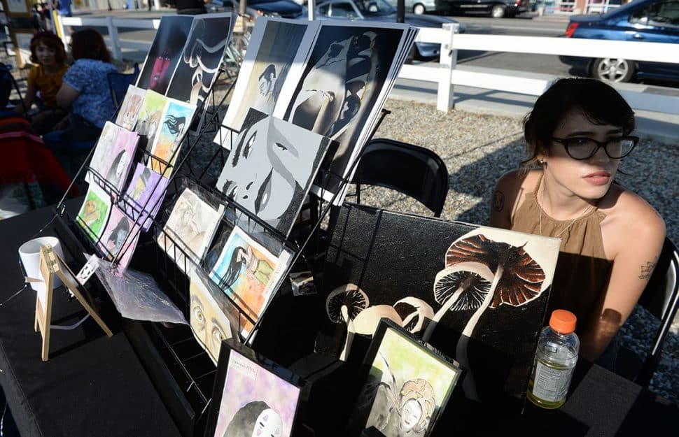 Artist Kim McIntoch at her booth during Summer LuvinÕ Fest, at 5301 Long Beach Boulevard in North Long Beach Saturday. The free family friendly event featured multiple bands, as well as vendors, artists and the Long Beach local El Exclusivo food truck on site in Long Beach Saturday, September 1, 2018.<br /> Photo by Stephen Carr / For The Long Beach Post