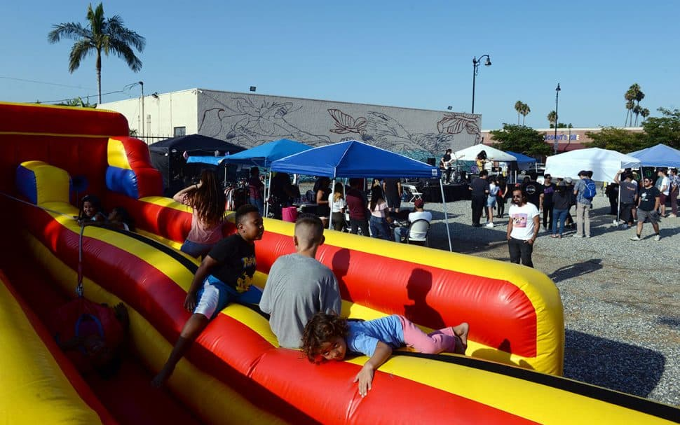 Kids play during Summer LuvinÕ Fest, at 5301 Long Beach Boulevard in North Long Beach Saturday. The free family friendly event featured multiple bands, as well as vendors, artists and the Long Beach local El Exclusivo food truck on site in Long Beach Saturday, September 1, 2018. .<br /> Photo by Stephen Carr / For The Long Beach Post