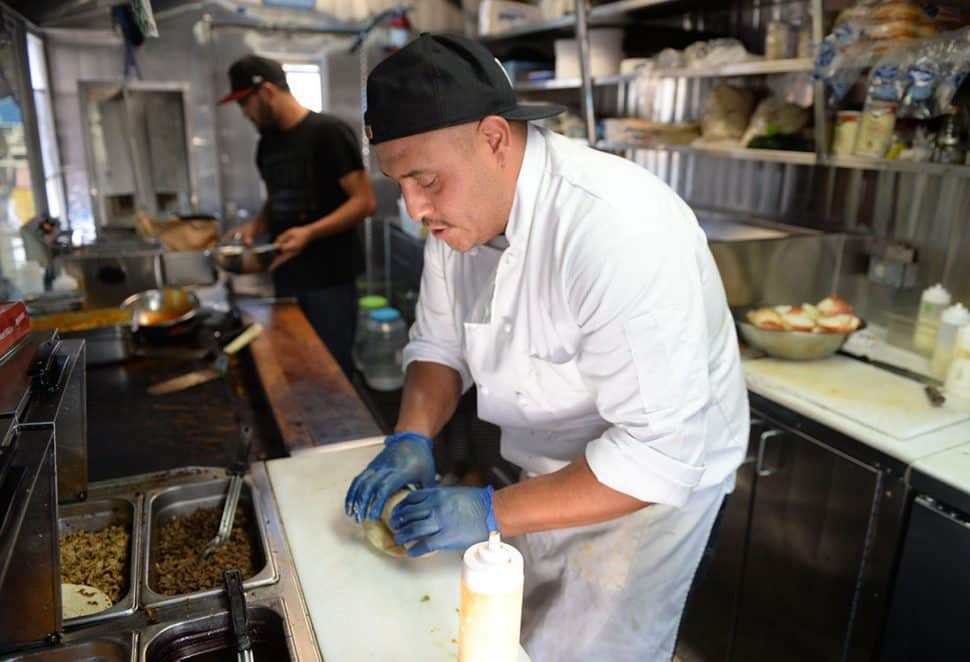 Chef and owner of Long Beach local El Exclusivo food truck Jorge Recendez makes a burrito, during Summer LuvinÕ Fest, at 5301 Long Beach Boulevard in North Long Beach Saturday. The free family friendly event featured multiple bands, as well as vendors, artists in Long Beach Saturday, September 1, 2018.<br /> Photo by Stephen Carr / For The Long Beach Post