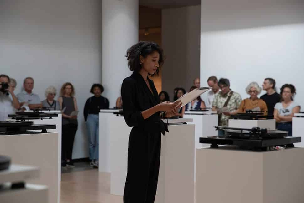 Lauren woods talks about her art installation, American MONUMENT, on display at the University Art Museum in Long Beach, Sunday, September 16, 2018. Photo by Kelly Smiley