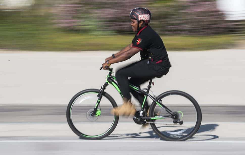 Jassiah Smith,14 of Long Beach, rides his new bike after the Long Beach police took a collecting to replace his bike after it was stolen over the weekend in Long Beach October 23, 2018. Photo by Thomas R Cordova.