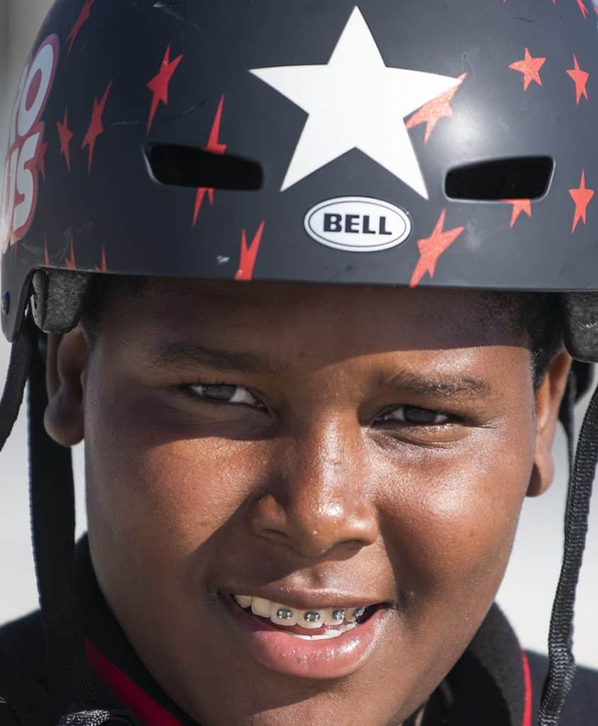 Jassiah Smith,14 of Long Beach, with his new bike helmet after the Long Beach police took a collecting to replace his bike after it was stolen over the weekend in Long Beach October 23, 2018. Photo by Thomas R Cordova.