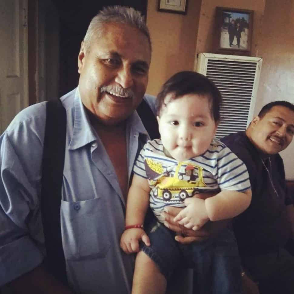 Jose Raul Corrales holds his great-grandson. Corrales was shot to death in West Long Beach on Oct. 9, 2018. Photo courtesy Jerry Amaya-Rodriguez.