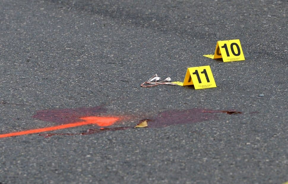 Long Beach Police marked a blood spot and ear buds at the scene of an crash, where a skateboarder was struck by a vehicle at the intersection of Bellflower Boulevard and 27th Street on Tuesday, Nov. 27, 2018. Photo by Stephen Carr.