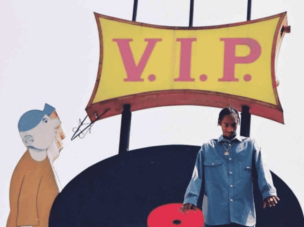 """Snoop Dogg performing """"Who Am I? (What's My Name?)"""" near the now-taken down VIP Records sign."""