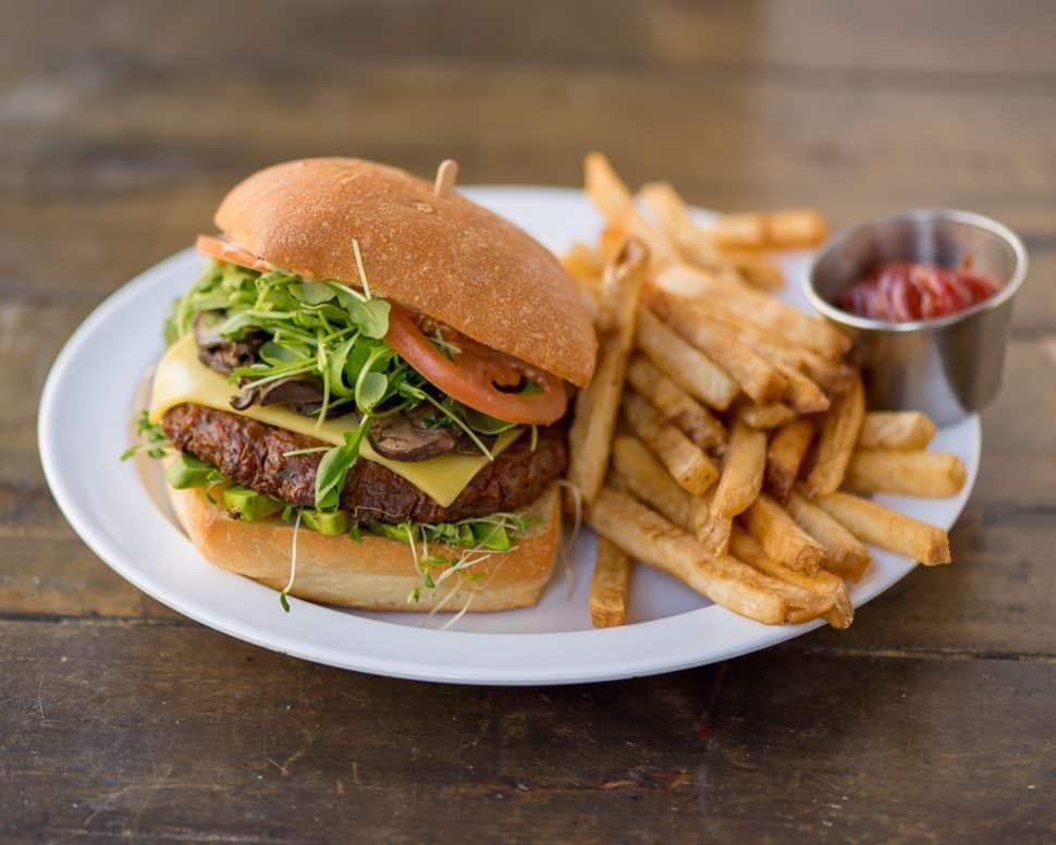 Ahimsa's popular vegan burger with fries. Courtesy of Ahimsa.
