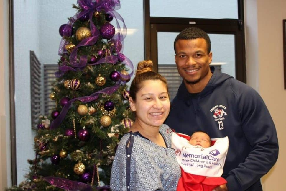Alysa and Anthony Riggins prepare to bring 2-day-old Anthony Jeremiah home for Christmas with a giant, red stocking.