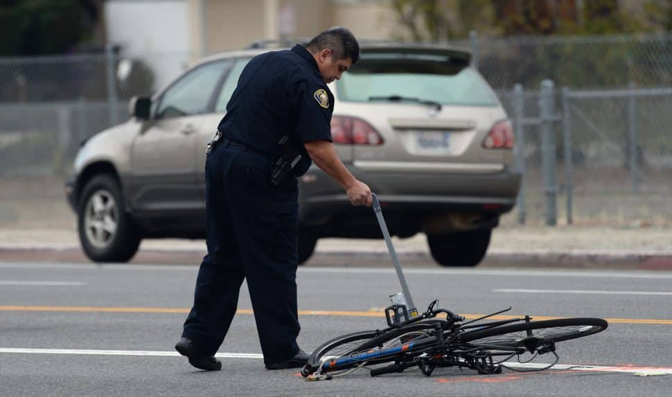 A Long Beach Police officer at the scene of a fatal car accident involving a bicyclist, at the corner of Los Coyotes Diagonal and Palos Verdes Avenue, Wednesday January 30th, 2019. Photo by Stephen Carr / For the Long Beach Post