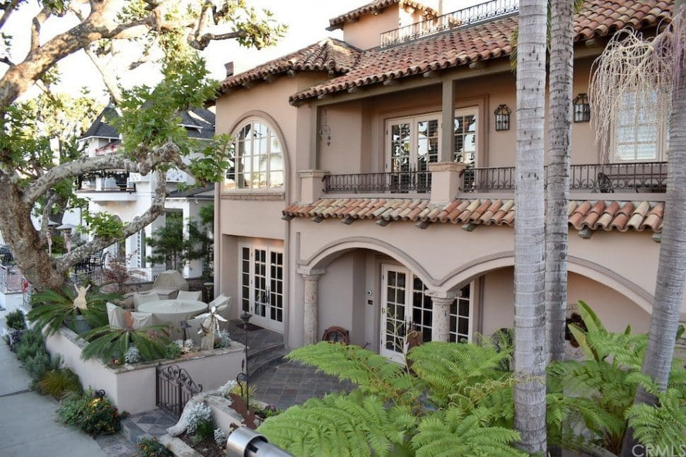 An opulent, 3-story mansion in the Mediterranean style on the canal in Naples.