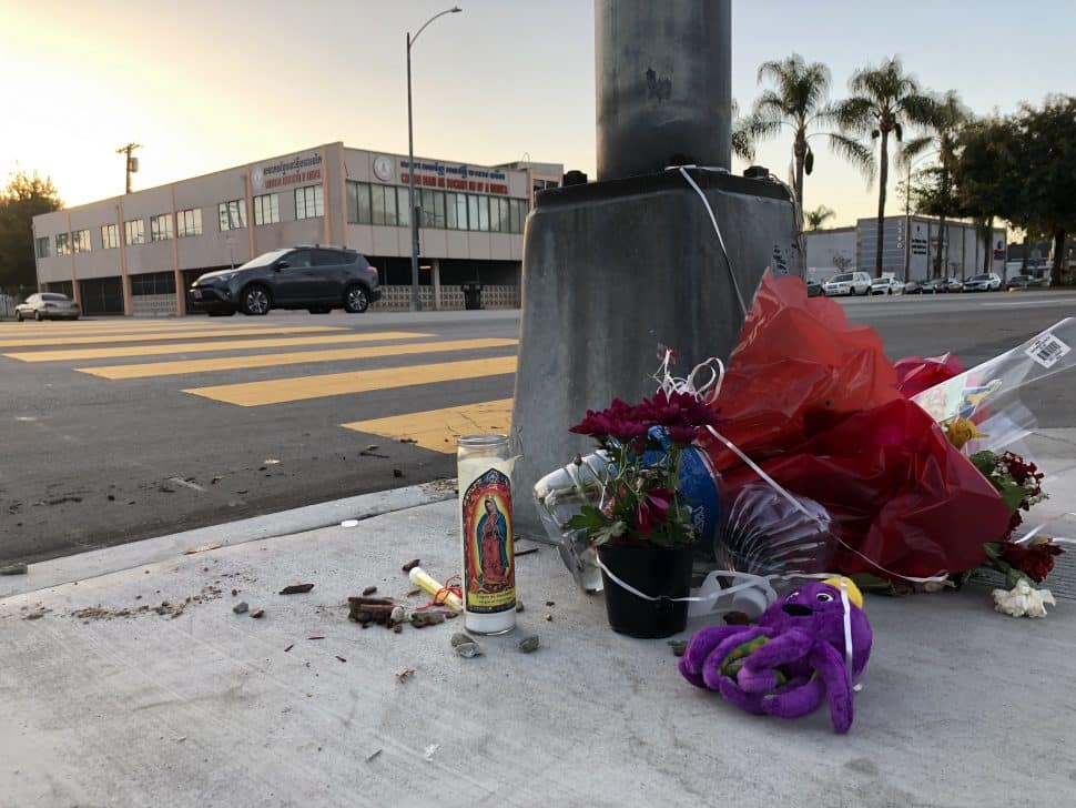 A week later, a small memorial still sits at Pacific Avenue and Burnett Street where a man was killed in a crosswalk on Feb. 18, 2019. Photo by Jeremiah Dobruck.