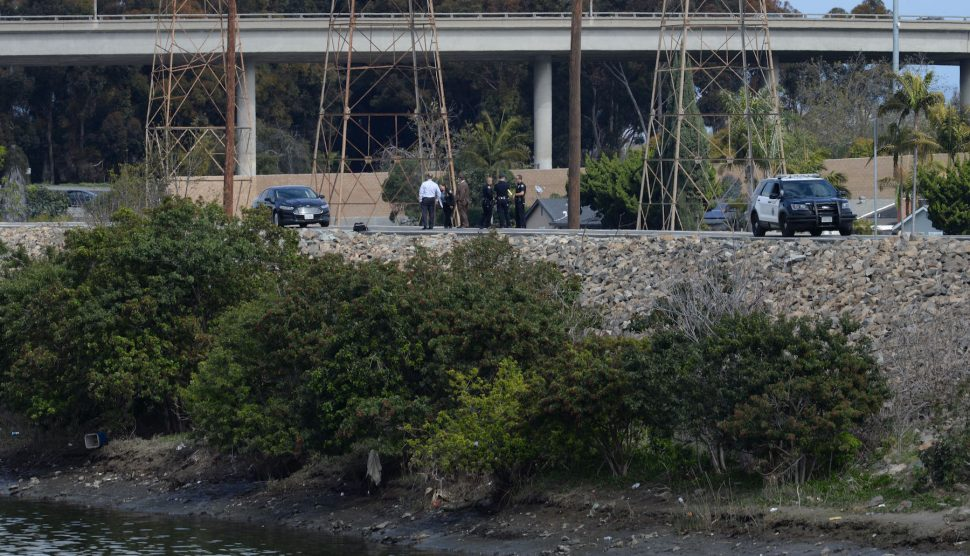Long Beach Police and Fire Department on the scene where a body of a man was discovered on the East side of the San Gabriel river, near Willow Street and College Park Drive in Long Beach California, Monday, March 4, 2019. Photo by Stephen Carr