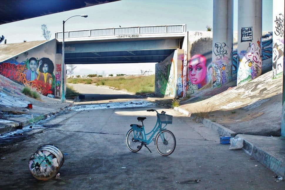 A collage of StreetArtistsInResidence murals and graffiti under the 6th Street bridge in Long Beach on Sep. 9, 2018. Photo by Matt Cohn.