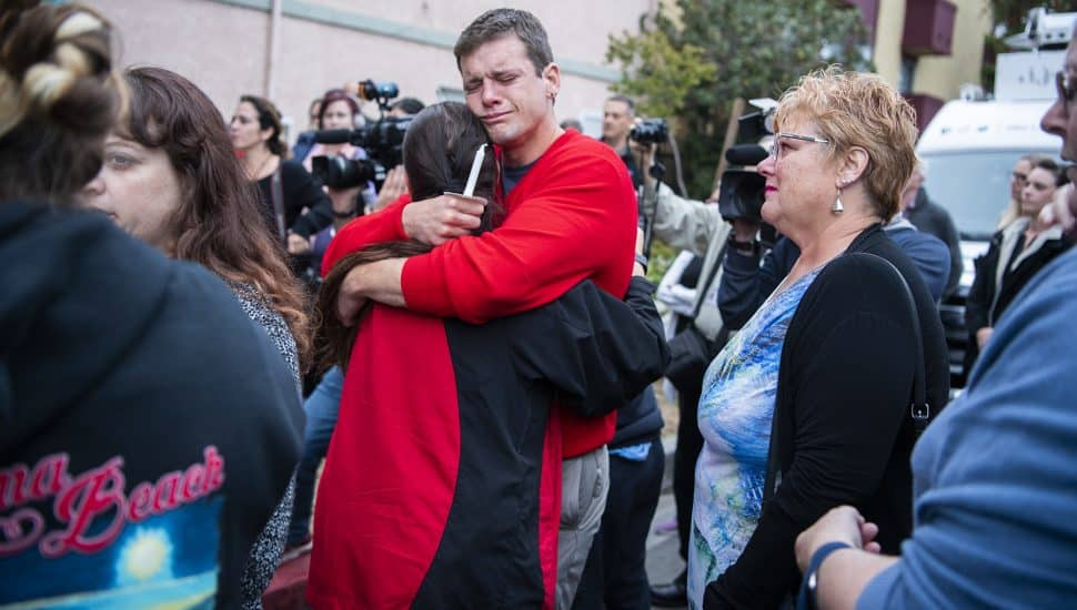 James Ridgers embraces a friend as he attends a candlelight vigil for his friend Jessica Bingman, 41, and the 5 dogs that died in a car accident at Bluff Heights in Long Beach Wednesday, May 08, 2019. Tuesday morning a driver who'd been fleeing from police crashed, killing Bingman and the five dogs in the car he hit. Photo by Thomas R. Cordova.