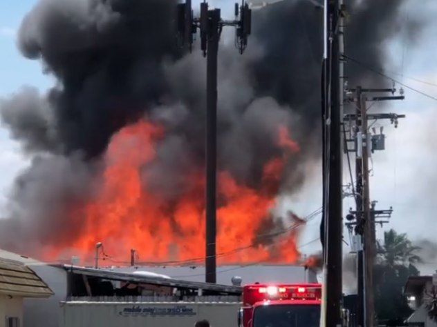 Flames burn at a industrial building near 59th Street and Downey Avenue in Long Beach. Courtesy Cheryl Davenport Sullivan.