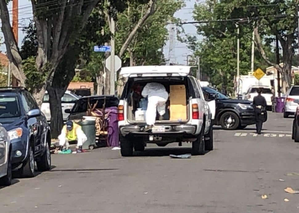Crews clean up the scene where a woman was attacked and killed with a scooter. Photo by Jeremiah Dobruck.