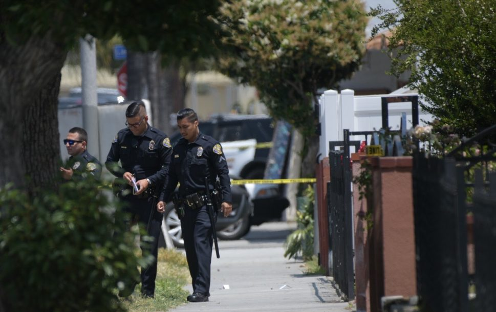 Officers search for evidence after the shooting. Photo by Thomas R. Cordova.