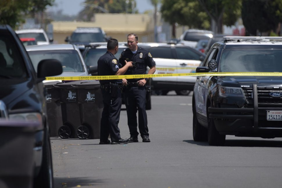 Police investigate a shooting near Poly High School. Photo by Thomas R. Cordova.